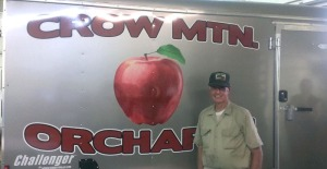 Orchard owner, Robert Deutscher, in front of new trailer used at the farmers markets.